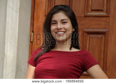 A Young Hispanic Happy Smiling Teen Girl