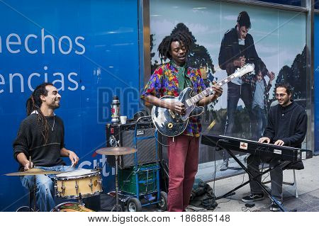 Buenos Aires Argentina - October 4 2013: Street musicians playing in a street of the city of Buenos Aires in Argentina