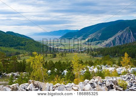 View of Lake Baikal and Buguldeika village from the mountain. Siberia, Russia
