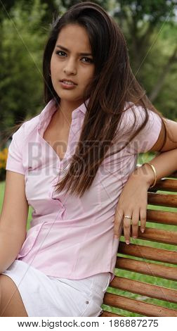 Serious Teen Girl  Sitting on Park Bench