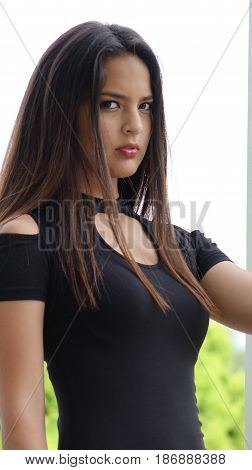 Serious Female Teen Wearing a Black Dress