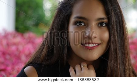 Smiling Hispanic Girl Teen with Purple Flowers