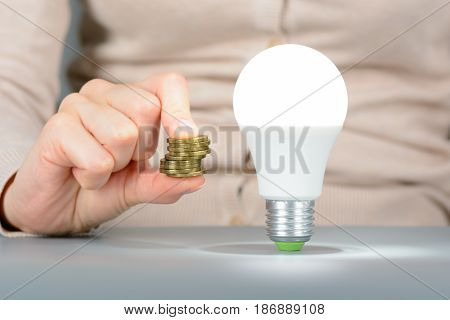 Woman Keep Your Coins And Led Light Bulb