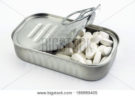 Tin metal contains pills on background, healtcare concept