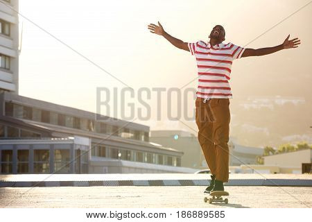 African Man Riding Skateboard On Street