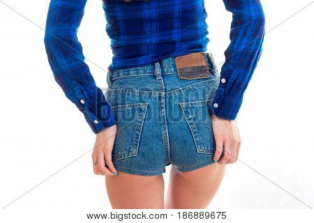 women's buttocks in short denim shorts close-up isolated on white background