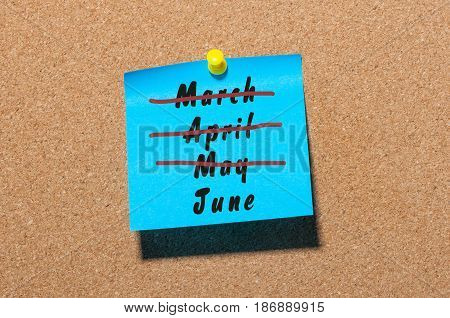 June - First summer month beginning. Crossed out March, April and May monthes at blue sticker pinned to notice board. Hello june concept. Happy Childrens Day.