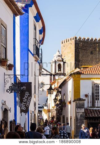 OBIDOS PORTUGAL - APRIL 03 2017: People walking on the main street of Obidos on April 03 2017.