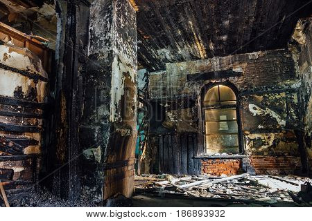 Interior of old mansion after fire. All wooden parts are burnt