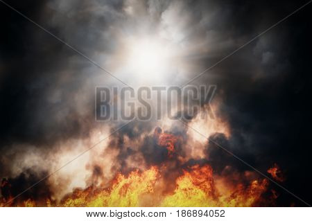 Fire and smoke. Dramatic texture. The sun is through black smoke.