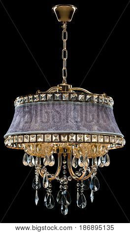 Contemporary bronze chandelier, velvet design isolated on black background. Crystal chandelier.