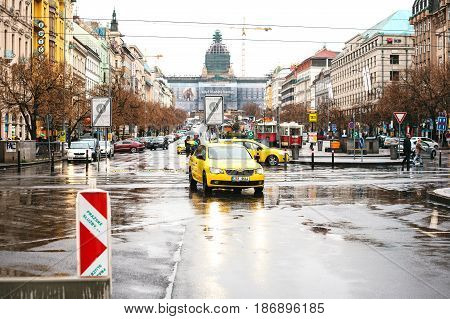 Prague, Czech Republic - December 24, 2016 - yellow taxi on the faces of the city. Europe