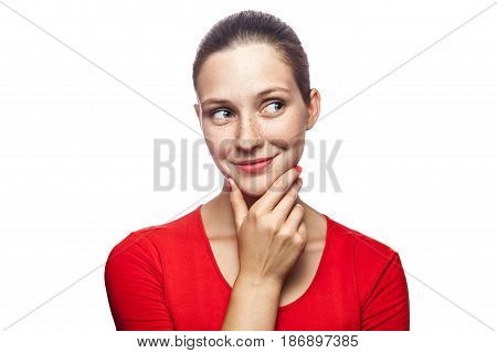 Portrait of thoughtful happy woman in red t-shirt with freckles studio shot. isolated on white background.