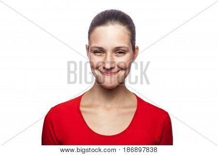 Portrait of satisfied funny woman in red t-shirt with freckles. looking at camera studio shot. isolated on white background.