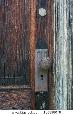 Old wooden door with rusty door knob