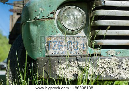 HOT SPRINGS VIRGINIA- MAY 8 2017: Old pick up truck abandoned by the side of the road.