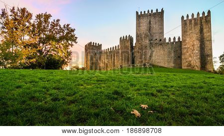Guimarães Portugal - November 23 2014 : End of a sunny day in the autumn next to the castle of Guimarães