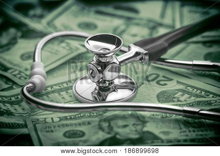 Healthcare cost concept shot with money and stethoscope
