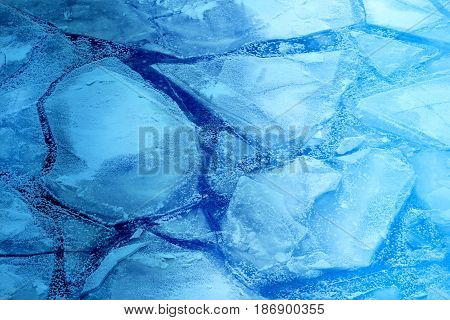 Beautiful large ice floes on the river photographed in close-up