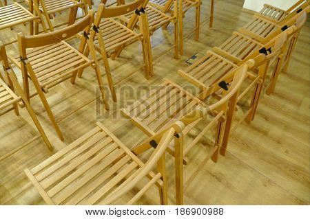 Lines Of Wooden Chairs Prepared For Audience