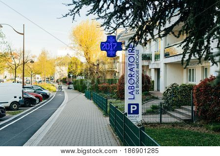 STRASBOURG FRANCE - MAR 31 2017: Biological laboratory Bio67 signage on the street of French city of Strasbourg early in the morning - Laboratoire de Biologie Medicale