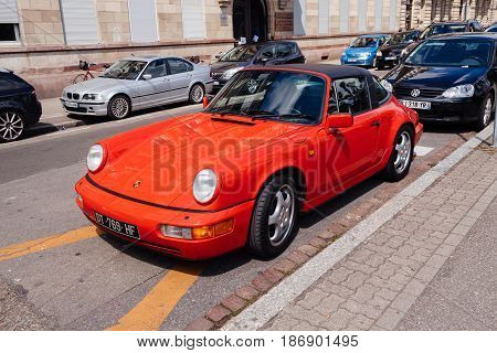 STRASBOURG FRANCE - APR 23 2017: Vintage red Cabrio red Porsche 911 parked in city center. The Porsche 911is a two-door 2+2 high performance and one of the most powerful sports cars made since 1963