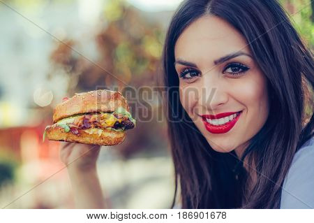 Happy Young Woman Eat Tasty Fast Food Burger