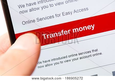 smartphone touch screen with red button transfer money. business e-commerce concept.