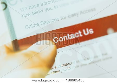 smartphone touch screen with red button contact us. business e-commerce concept.