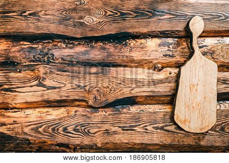 Background of burned pine wood with oak cutting board. Top view