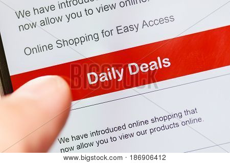 smartphone touch screen with red button daily deals. business e-commerce concept.