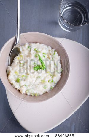 Risotto with Asparagus and cheese served on a table