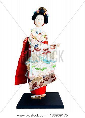 Japanese geisha doll isolated on white background.