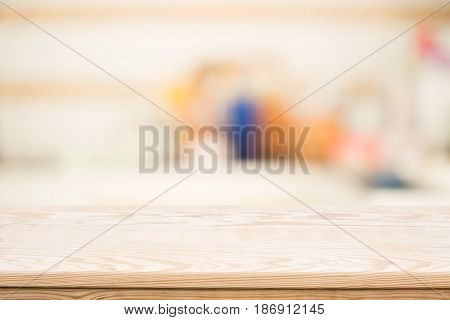 wood coordination table top on blurred background,Space available for the product