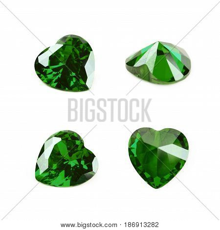 Heart shaped green gem stone isolated over the white background, set of four different foreshortenings