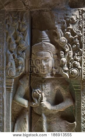 Carving detail in Ta Prohm Temple Cambodia.