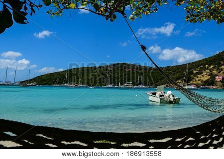 Boat in small, sandy cove, Tortola, BVI