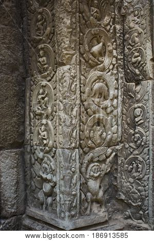 Ornate carving detail in Ta Prohm Temple Cambodia.