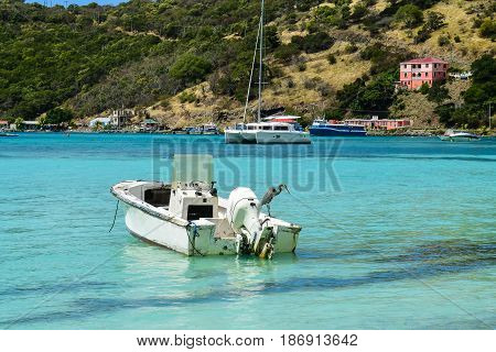 Small boat in quiet cove on Tortola, BVI