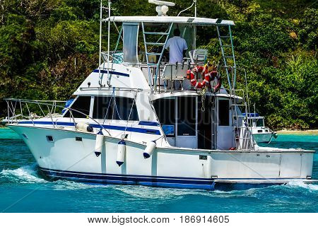 Fishing vessel cruises harbor, Yost Van Dyke, BVI