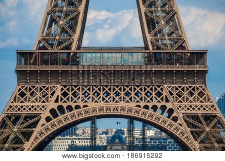 Lowest arch of Eiffel Tower Tour Eiffel blue sky steel structure
