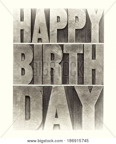 happy birthday greeting card - word abstract in letterpress wood type printing blocks, sepia toned image