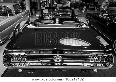 STUTTGART GERMANY - MARCH 03 2017: Pony car Ford Mustang V8 Cabrio GT 1967. Rear view. Black and white. Europe's greatest classic car exhibition