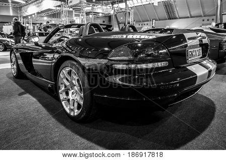 STUTTGART GERMANY - MARCH 03 2017: Sports car Dodge Viper SRT-10 2008. Rear view. Black and white. Europe's greatest classic car exhibition