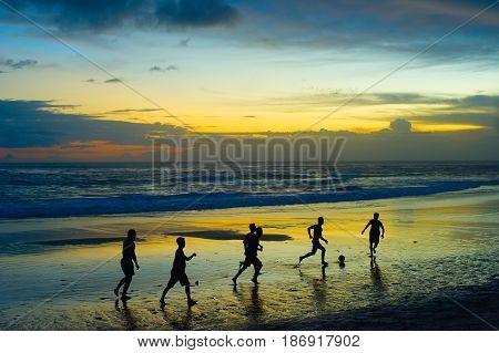 Football On The Beach. Silhouette