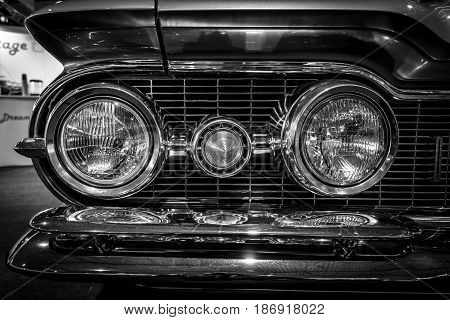 STUTTGART GERMANY - MARCH 03 2017: Headlamp of a full-size car Oldsmobile Super 88 1959. Close-up. Black and white. Europe's greatest classic car exhibition