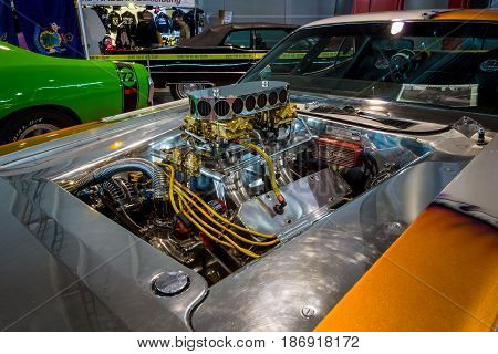 STUTTGART GERMANY - MARCH 03 2017: Engine of a muscle car Dodge Challenger Pro Street 1970. Close-up. Europe's greatest classic car exhibition