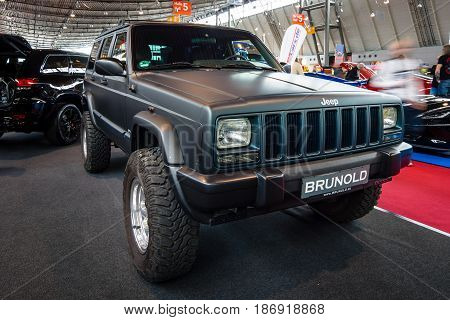 STUTTGART GERMANY - MARCH 03 2017: A fully capable off road SUV Jeep Cherokee (XJ) LTD 2000. Europe's greatest classic car exhibition