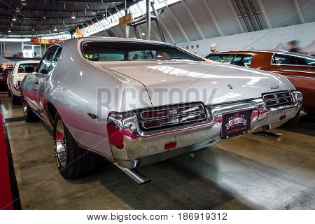 STUTTGART GERMANY - MARCH 03 2017: Muscle car Pontiac GTO 1969. Rear view. Europe's greatest classic car exhibition