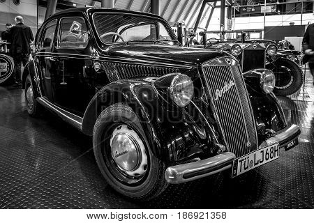 STUTTGART GERMANY - MARCH 03 2017: Small family car Lancia Ardea Berlina 1949. Black and white. Europe's greatest classic car exhibition